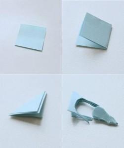 Промажьте одну сторону голубя клеем, приложите к центру нитку и придавите второй стороной голубя.