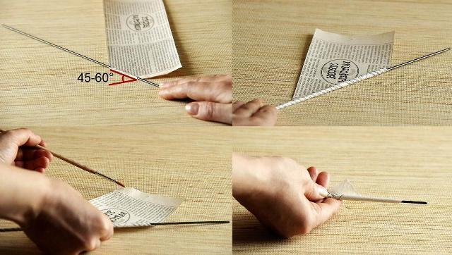 Начните наматывать газетные полоски на шпажку, а чтобы трубочка не развернулась, смажьте кончик клеем