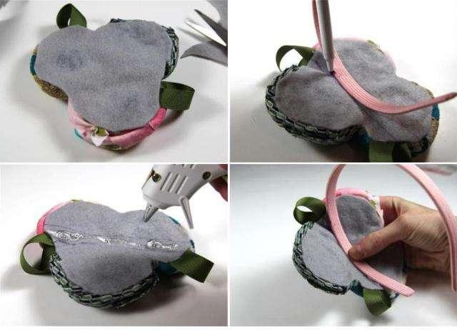 Из фетра вырежьте кружок. После этого центр цветка смажьте клеем и приклейте к фетру. Не забудьте приклеить листочки так, чтоб кончики ленты не были видны