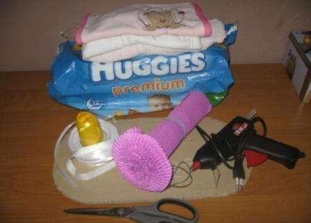 Подарок из памперсов для девочки своими руками: Коляска