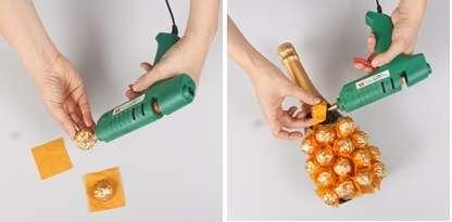 Для создания ананаса из конфет вам понадобятся обычные трюфеля, упакованные в фольгу. Желательно чтобы упаковка конфет была желтой или коричневой, то есть похожа на кожуру ананаса. После этого возьмите бумагу тишью желтого цвета и нарежьте её на одинаковые квадратики. Размер квадратов зависит от размера конфет.