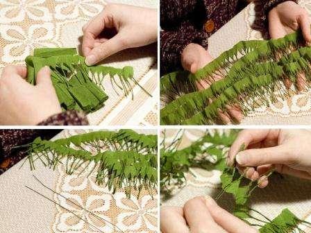 Возьмите кусочек зеленой проволоки, согните её пополам и зацепите вначале ленты с иголочками. Приступите к накручиванию иголок на ленту, слегка смещаясь по длине проволоки, чтобы получалась у вас настоящая хвойная веточка.