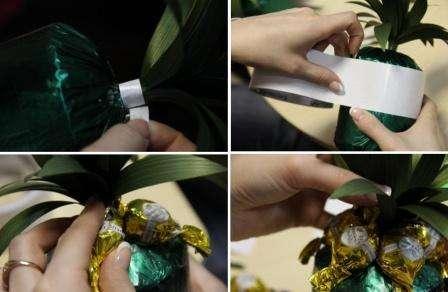 Теперь приступите к самому интересному этапу – наклеивание конфет. Начинайте лучше сверху, чтобы ананас получится красивыми.