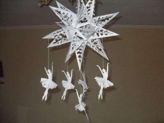 Как сделать объемную снежинку - балеринку из бумаги?