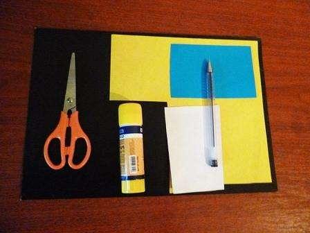 Вырежьте из желтого двухстороннего картона прямоугольник со сторонами 6 и 9 см.