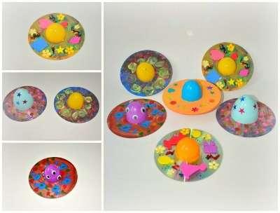 Оригинально будет смотреться летающая тарелка из CD-диска и половинки большого яйца от Киндер-сюрприза.