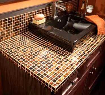 Керамическая плитка идеально подходит для изготовления столешницы в ванной комнате, так как она влагонепроницаемая, красивая и устойчивая к механическим повреждениям. Сделать столешницу из керамической плитки д